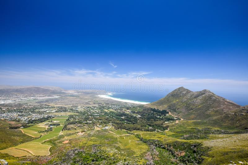 Panoramic view of Hout Bay, a town near Cape Town, South Africa, in a valley on the Atlantic seaboard of the Cape Peninsula royalty free stock photography