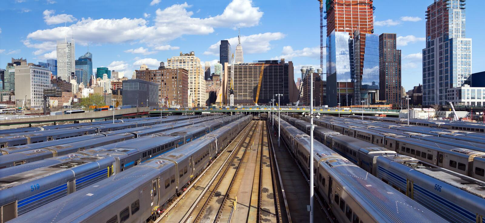 Hudson Yards train station with the Midtown Manhattan skyline in the background. Panoramic view of Hudson Yards train station with the Midtown Manhattan skyline royalty free stock photography