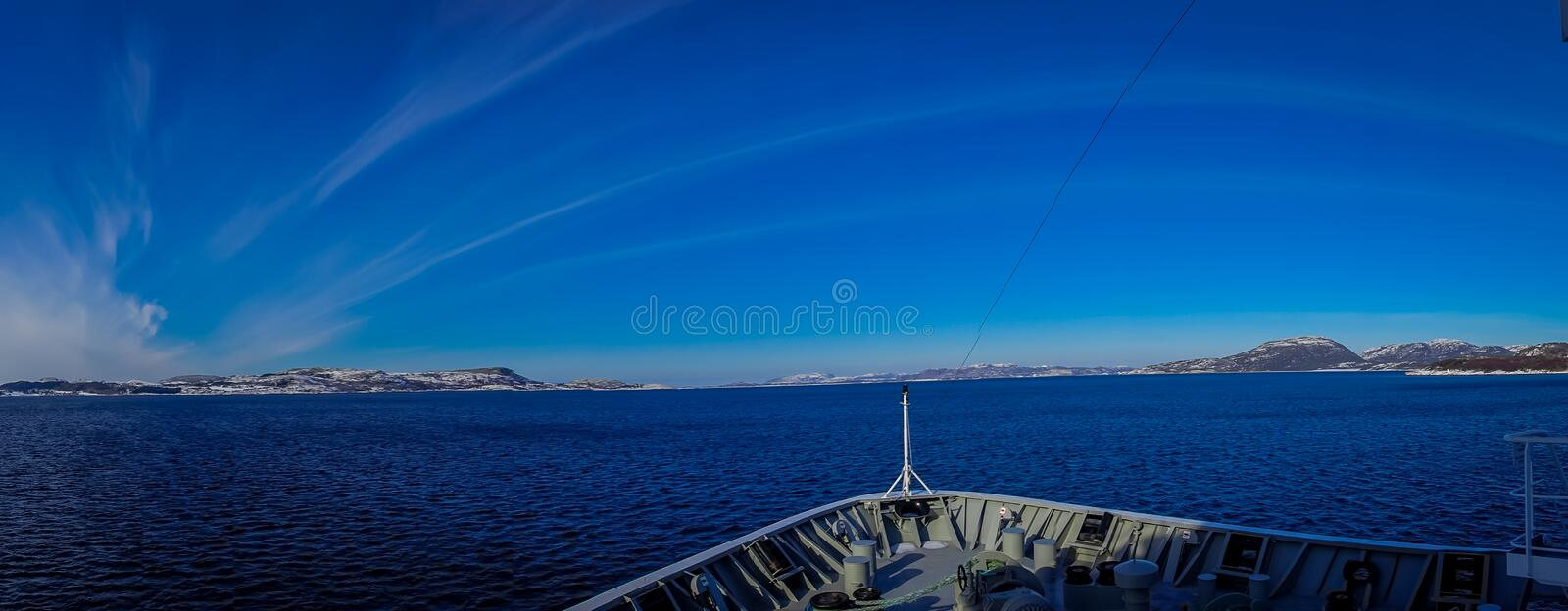 Panoramic view of hurtigruten Ship cruise, frontside. Sailing in a blue sky in Norway stock image