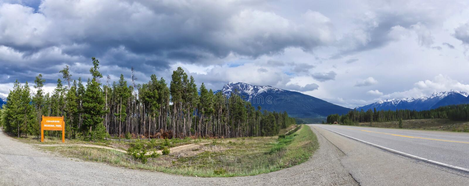 Panoramic view of Icefield parkway highway runs along the beautiful Rocky mountains in the summer in cloudy weather, British royalty free stock photo