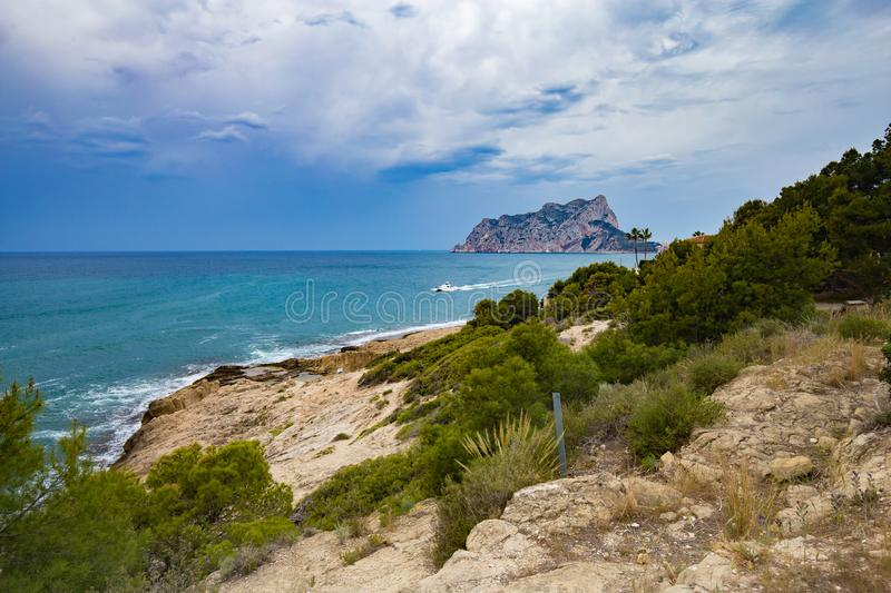Panoramic view of the Ifach Rock Natural Park or Penon de Ifach in the city of Calpe in Spain. View from Moraira Costa Blanca.  stock images