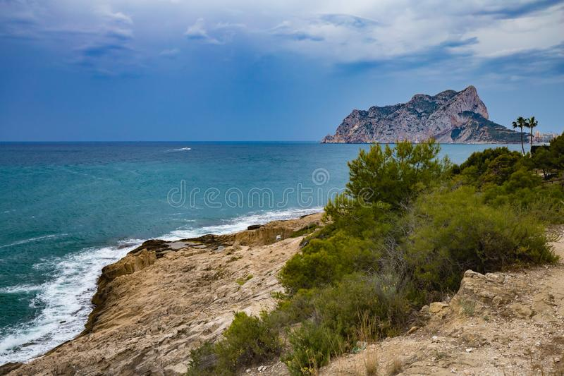 Panoramic view of the Ifach Rock Natural Park or Penon de Ifach in the city of Calpe in Spain. View from Moraira Costa Blanca.  royalty free stock photos