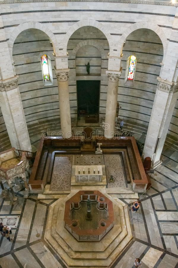 Panoramic view of interior of Pisa Baptistery of St. John  is a Roman Catholic ecclesiastical building in Pisa stock images