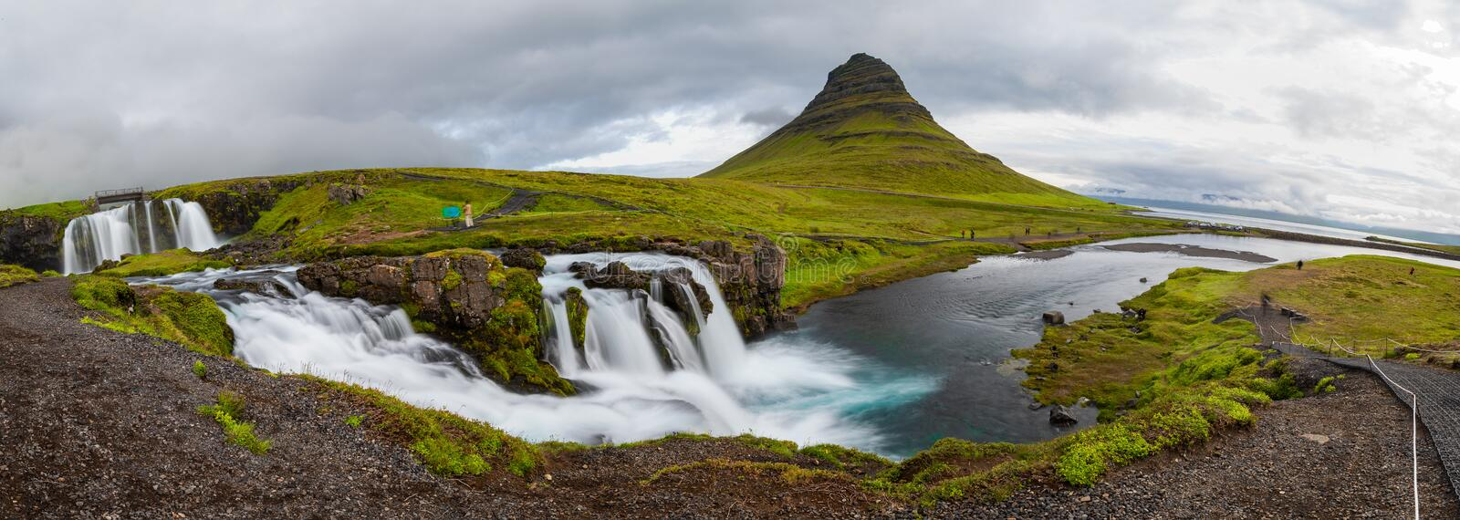 Panoramic view of Kirkjufellfoss and Kirkjufell mountain in cloudy day ,Iceland. royalty free stock image