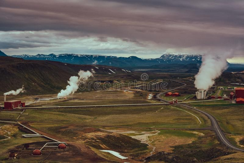 Panoramic view of Krafla geothermal power plant, near Krafla Viti Volcano, Northeastern Iceland, in summer, with some grain royalty free stock image