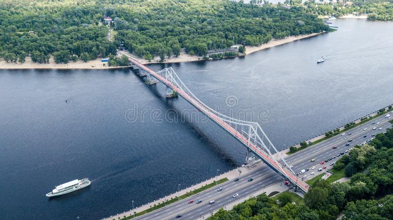 Panoramic view of Kyiv. Arch of Peoples Friendship, pedestrian bridge. View of Kyiv with a dron. royalty free stock image