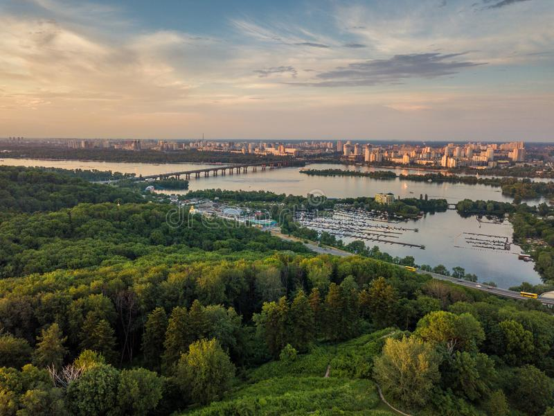 Panoramic view of Kyiv from the sky. Sunset over summer Kiev. Filmed on drone. Aerial view. stock photos