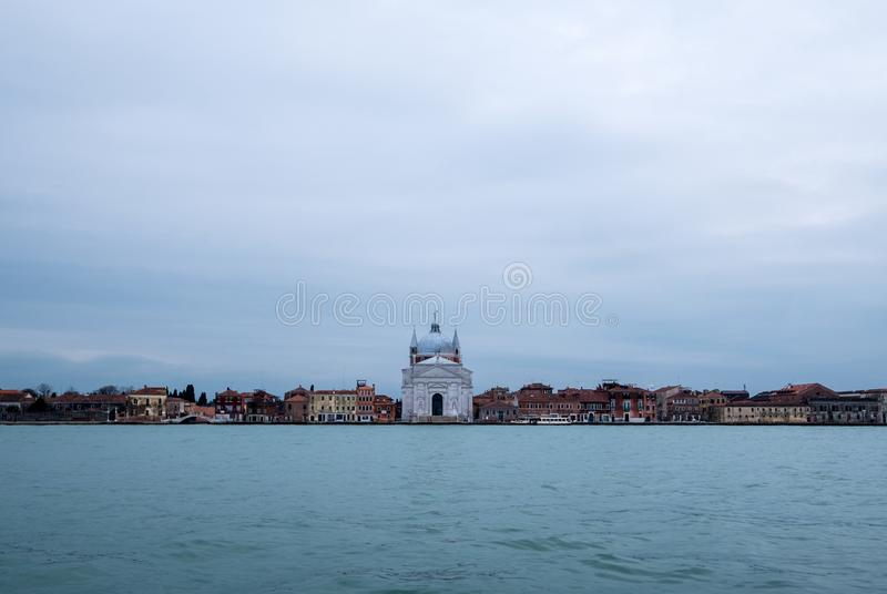 Panoramic view of La Giudecca taken from the lagoon at dusk on a cloudy winter`s day, Venice, Italy royalty free stock photography