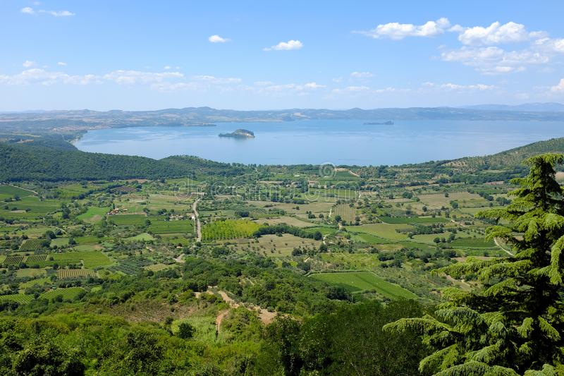 Ground version of Lake Bolsena in Italy. Panoramic view of the Lake Bolsena in Italy, near city of Viterbo, in the Natural Reserve of Tuscia royalty free stock photography
