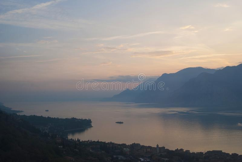 Panoramic view at Lake Garda landscape from top of Monte Baldo. Scenic view of sunset at Lake Garda in the evening, Veneto, Italy. Panoramic view at Lake Garda royalty free stock photo
