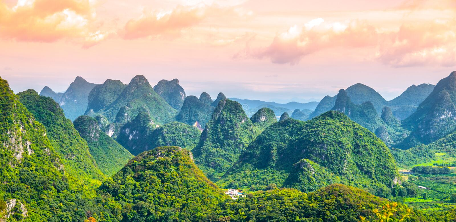 Panoramic view of landscape with karst peaks around Yangshuo County and Li River, Guangxi Province, China.  royalty free stock photo