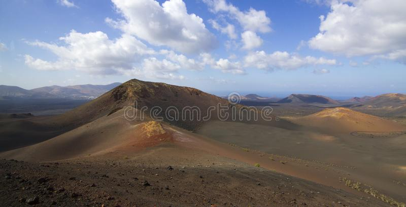 Panoramic view of Lanzarote volcanic island with blue cloudy sky. Travel nature tourism spain desert volcano canary landscape mountain lava rock beautiful stock photography