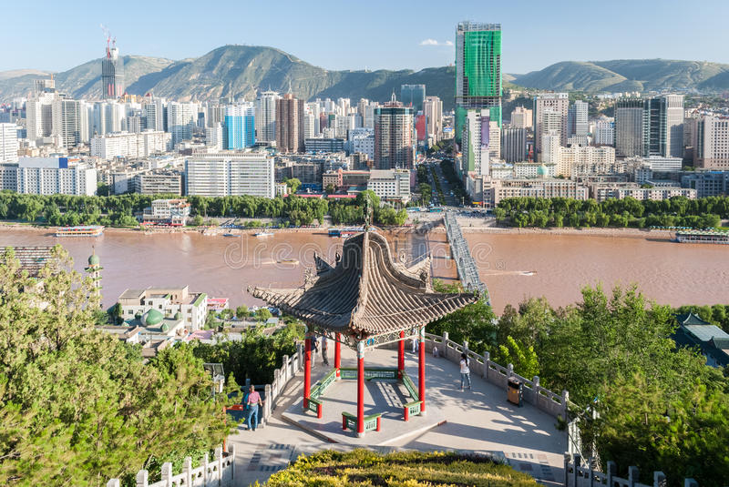 Panoramic view of Lanzhou China with a traditional temple in the foreground stock images