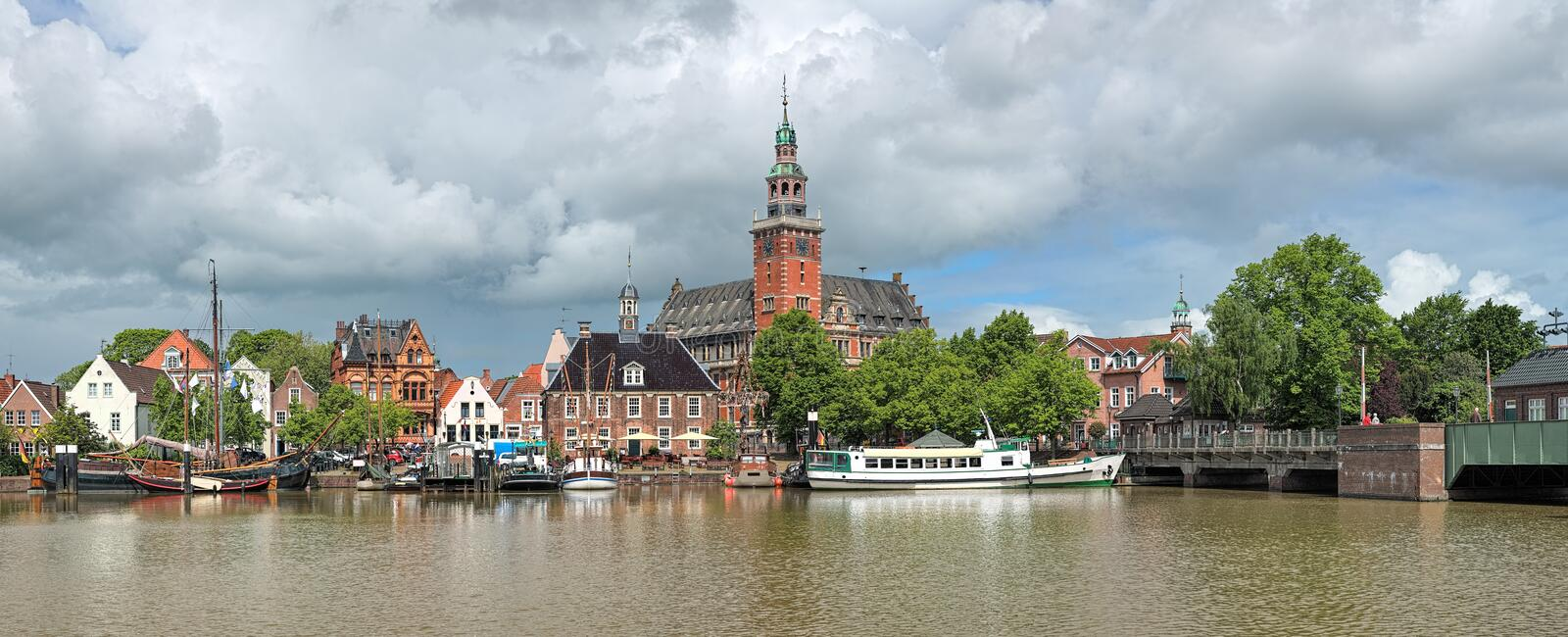 Panoramic view from Leda river on City Hall and Old Weigh House in Leer, Germany. Leer, Germany. Panoramic view from Leda river on City Hall in Dutch Renaissance royalty free stock image