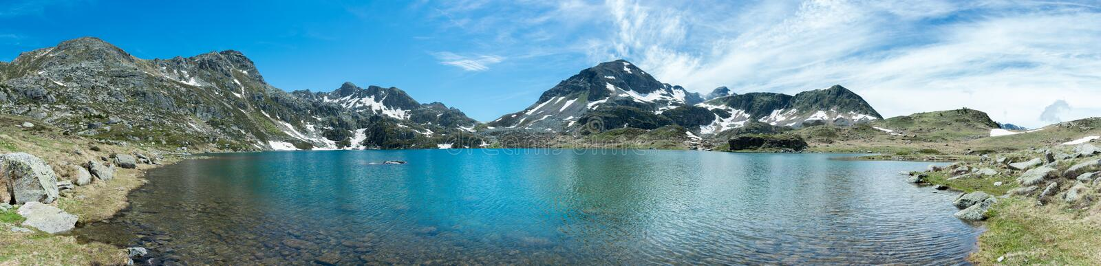 Panoramic view of Les Etangs de Fontargente in the French Pyrenees stock photography