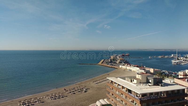 Panoramic view of Levante beach and the fishing port in Santa Pola royalty free stock image