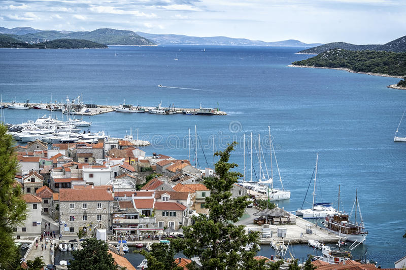 Panoramic view of the little fishing village. In the background view of the islands and clear blue Adriatic Sea stock image