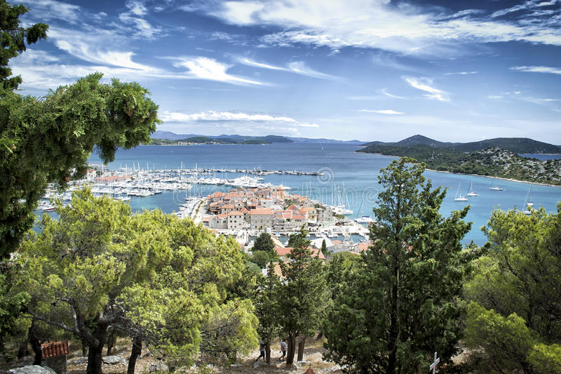 Panoramic view of the little fishing village and the islands in background. Panoramic view of the little fishing village in the background view of the islands stock photo