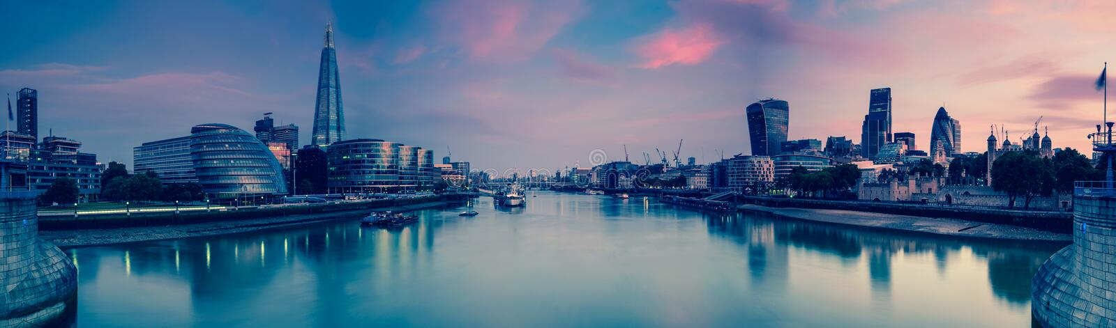 Panoramic view on London and Thames at twilight, from Tower Bridge stock photography