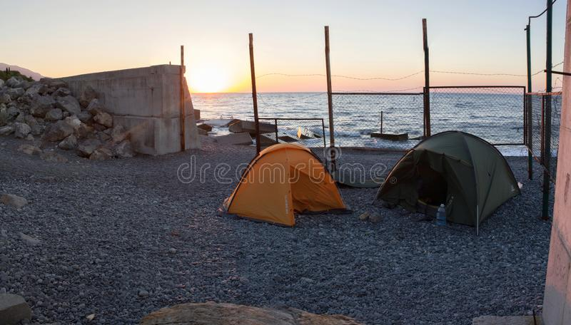 Panoramic view of lonely tourist tents on the beach. stock photos