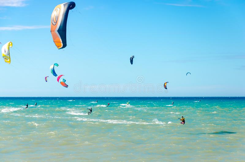 Panoramic view with lots of people doing kitesurfing. Cumbuco, Brazil, jul 9, 2017: Panoramic view with lots of people doing kitesurfing on the beach of Cumbuco stock photos