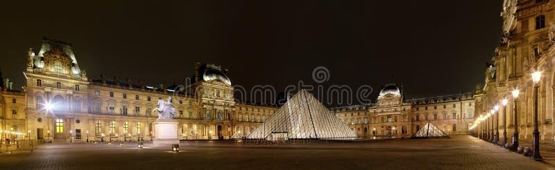 Panoramic view of Louvre Art Museum at night stock photo