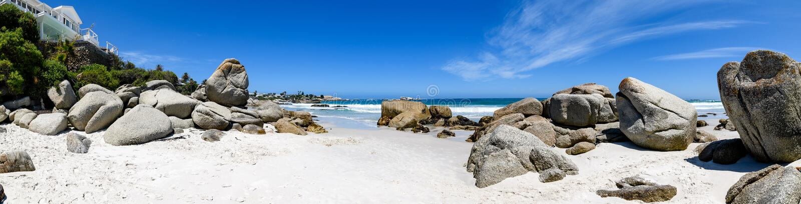A panoramic view looking down on the beautiful white sand beaches of clifton in the cape town area of south africa.4. A panoramic view from the luxury apartments royalty free stock photos