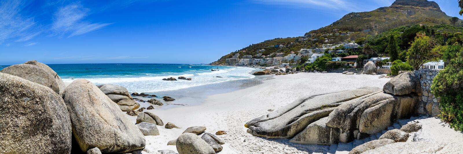A panoramic view looking down on the beautiful white sand beaches of clifton in the cape town area of south africa.6 stock photo