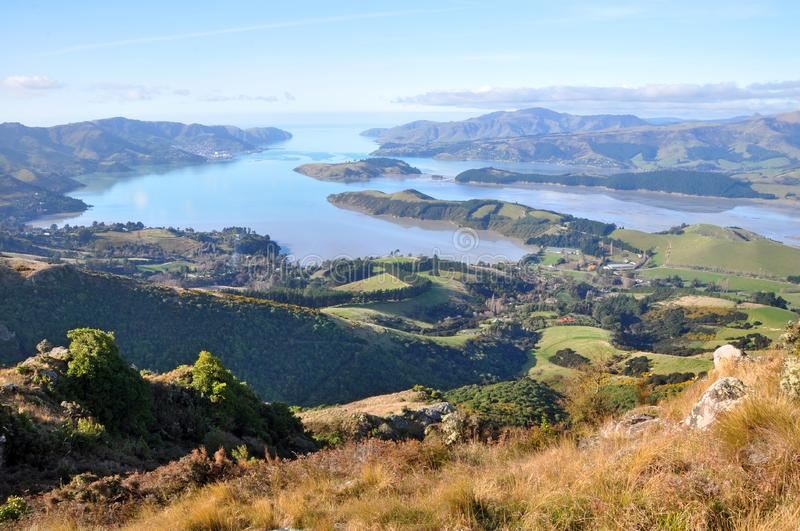 Lyttelton Harbour Panorama, Christchurch, New Zealand. A panoramic view of Lyttelton Harbour at low tide from the top of the Christchurch Port Hills, Canterbury royalty free stock photography