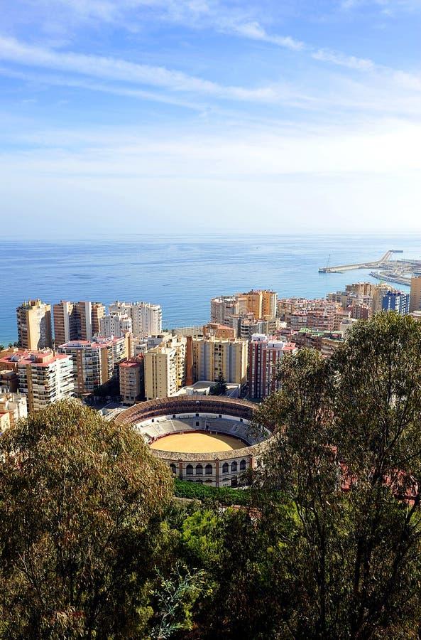 Panoramic view of Málaga with the Malagueta bullring, Andalusia, Spain. The bullring in Malaga called Malagueta, view Gibralfaro with the Mediterranean sea in stock photos