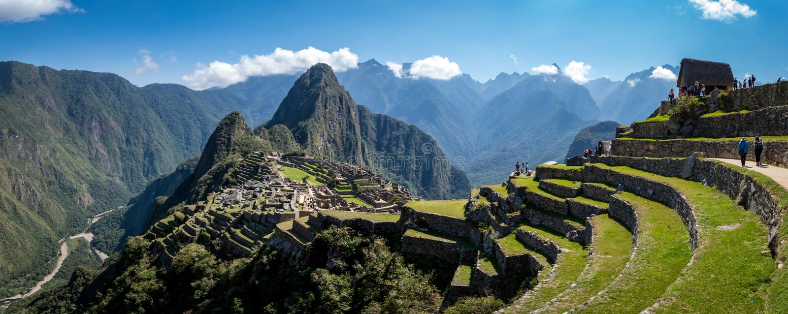 Panoramic view of Machu Picchu ruins in Peru. Behind we can appreciate big and beautiful mountains full of green vegetation. Archaeological site, UNESCO World stock images