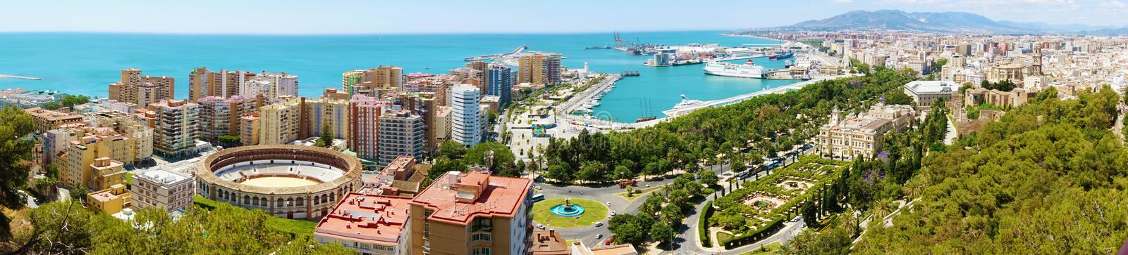 Panoramic view on Malaga City. Cityscape of Malaga with down town center with Cathedral, Mediterranean Sea port harbor stock photography