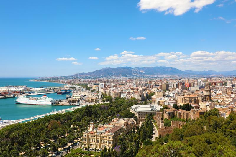 Panoramic view on Malaga City. Cityscape of Malaga with down town center with City Hall, Cathedral and Mediterranean Sea port royalty free stock photo