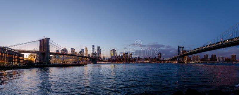 Panoramic view of Manhattan and Brooklyn Bridge at sunset - New York, USA stock images