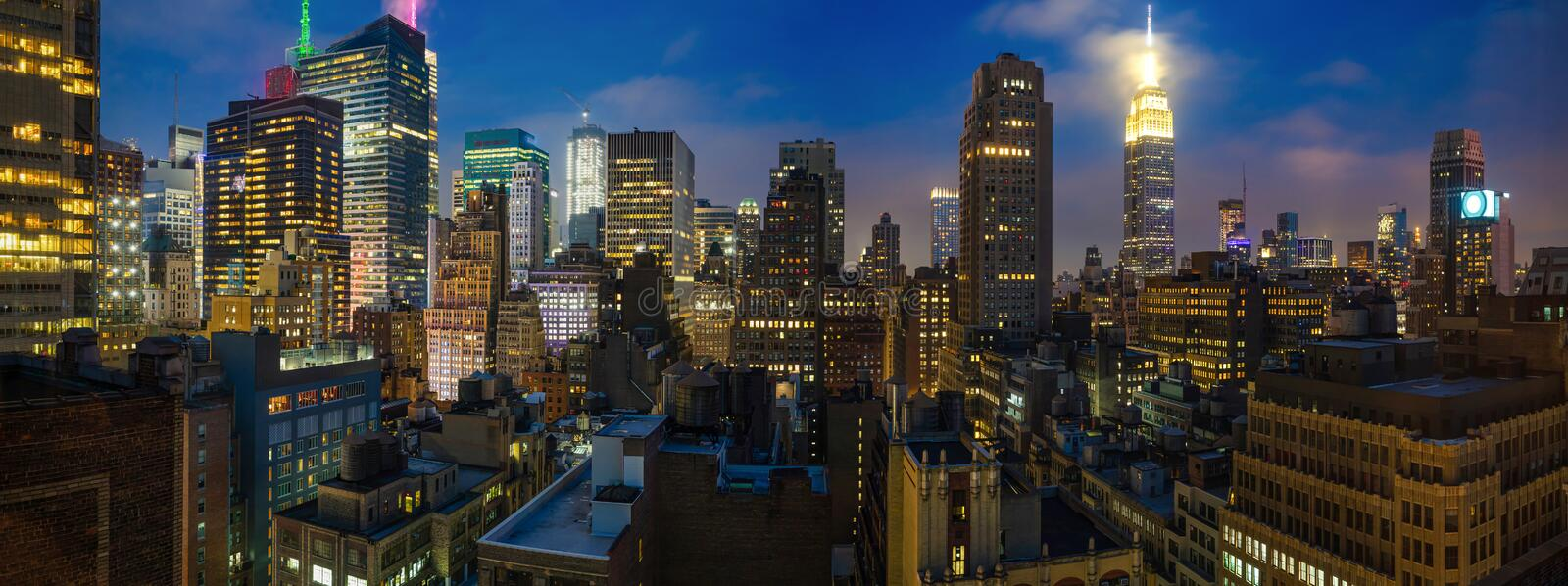 Panoramic view of Manhattan skyscrapers lights, New York city, in the evening stock images