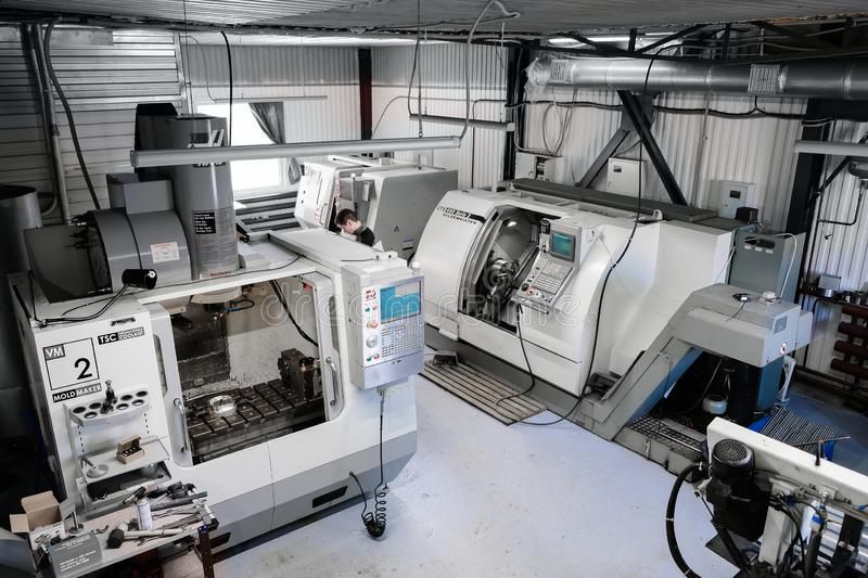 Panoramic view on manufacturing facility with CNC lathe machines. CNC milling machine for working and producing a metal detail. stock photos