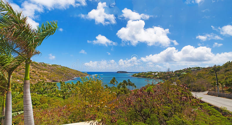 Panoramic view of Marigot beach, roofs, houses, palms, view, sea, St Barth stock photos