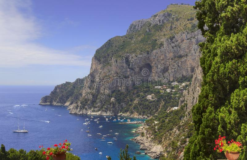 Panoramic view of Marina Piccola and Tyrrhenian sea in Capri island - Italy. Marina Piccola. Boats and yachts in clear blue mediterranean sea water. Capri. Italy royalty free stock image