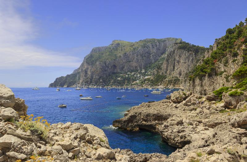Panoramic view of Marina Piccola and Tyrrhenian sea in Capri island - Italy. Marina Piccola. Boats and yachts in clear blue mediterranean sea water. Capri. Italy stock images