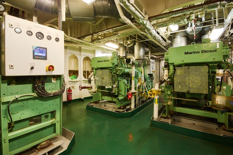 Panoramic view of marine diesel generators on a merchant ship in the engine room royalty free stock image