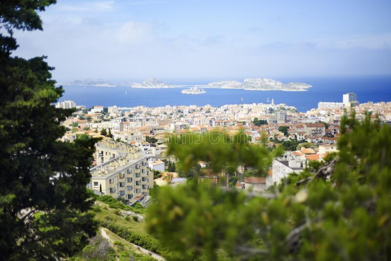 Panoramic view of Marseille, Provence, France in summer day time with famous prison If castle on background. Rooftops of Marseille. Old town capital of Provence royalty free stock images