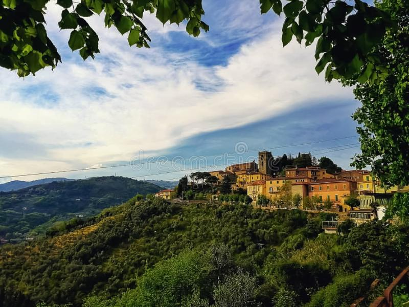 A panoramic view of a medieval village and hills in Tuscany royalty free stock image