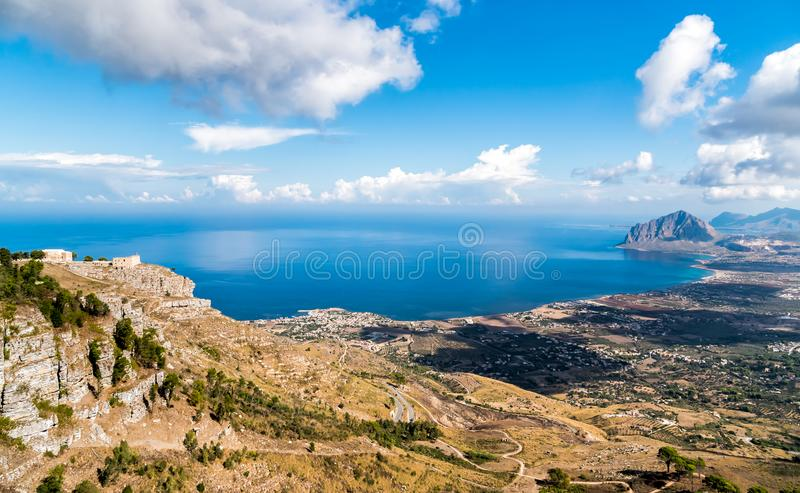 Panoramic view of mediterranean sea, coastline and Monte Cofano from Venus Castle of Erice, Sicily. Panoramic view of mediterranean sea, coastline and Monte royalty free stock photography