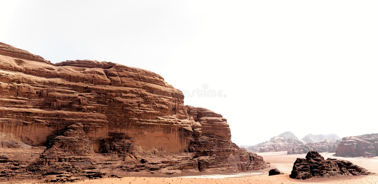 Panoramic view from the mighty rocky landscape in the desert of Wadi Rum, Jordan royalty free stock photography
