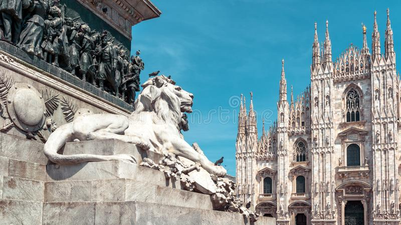 Panoramic view of the Milan city center with sculpture of lion in summer, Italy. Famous Milan Cathedral Duomo di Milano in. Background. Gothic Milan Cathedral royalty free stock photos