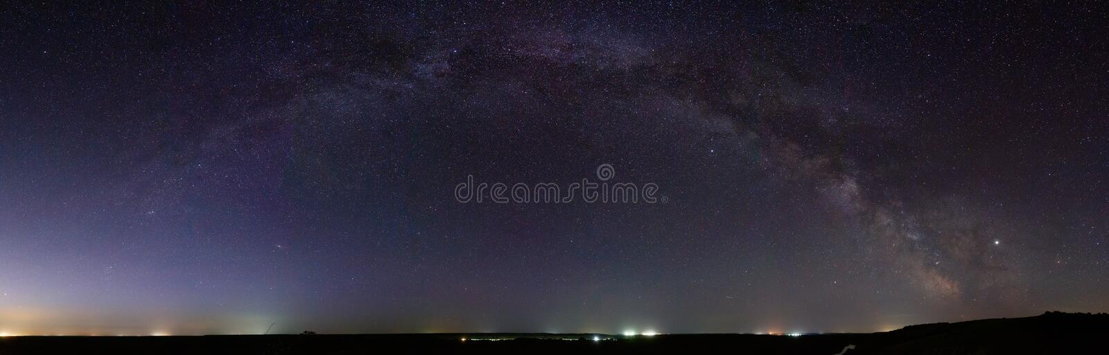 Panoramic view of the Milky Way. Bright stars of the night sky. Astrophotography with a long exposure royalty free stock photography
