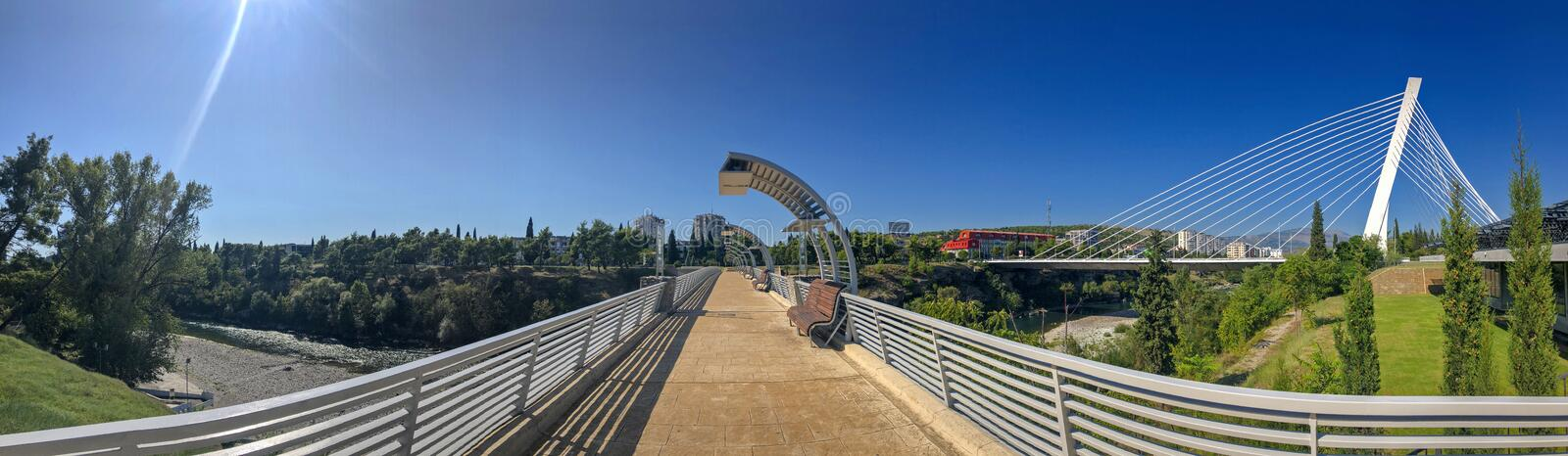 Panoramic view of the Millenium Brigde, from a project by Santiago Calatrava, seen from the Moscow Bridge. Montenegro. Podgorica. Panoramic view of the Millenium royalty free stock photo