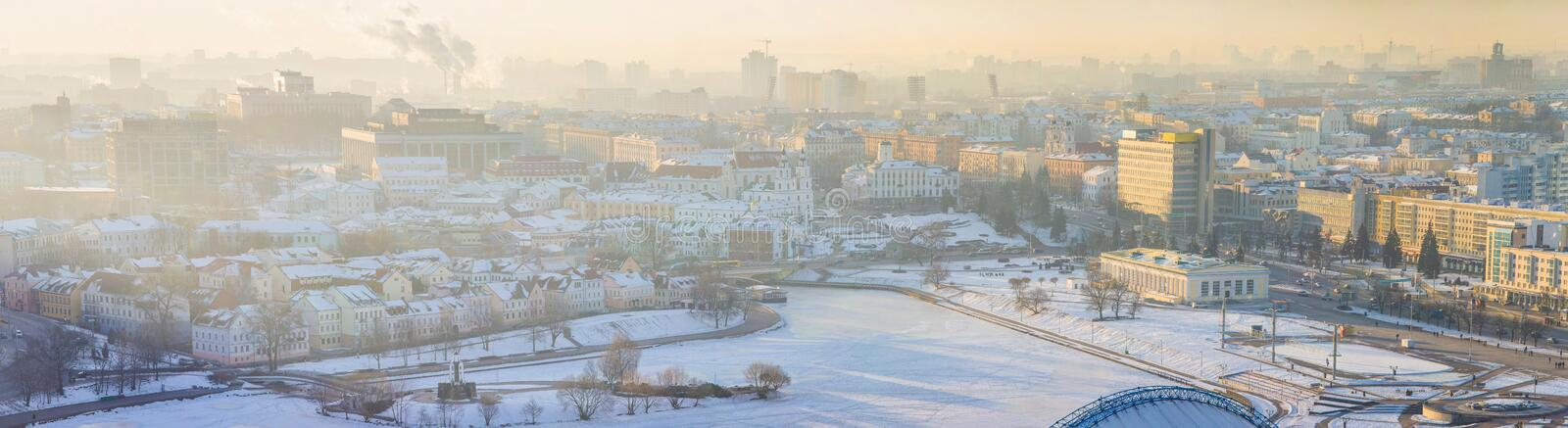 Panoramic view of Minsk downtown on early winter morning. Nemiga district and Trinity Suburb covered with thick snow stock images