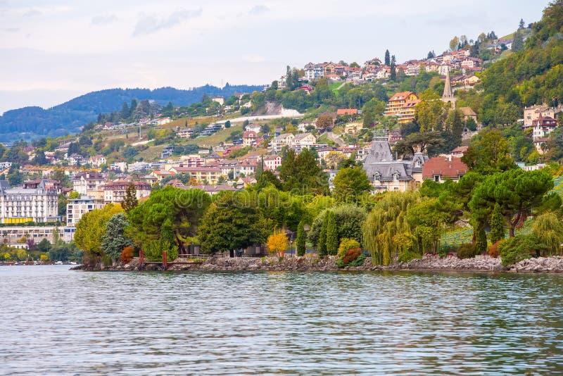 Montreux and Lake Geneva, Switzerland. Panoramic view of Montreux and Lake Geneva, Switzerland with promenade trees stock image