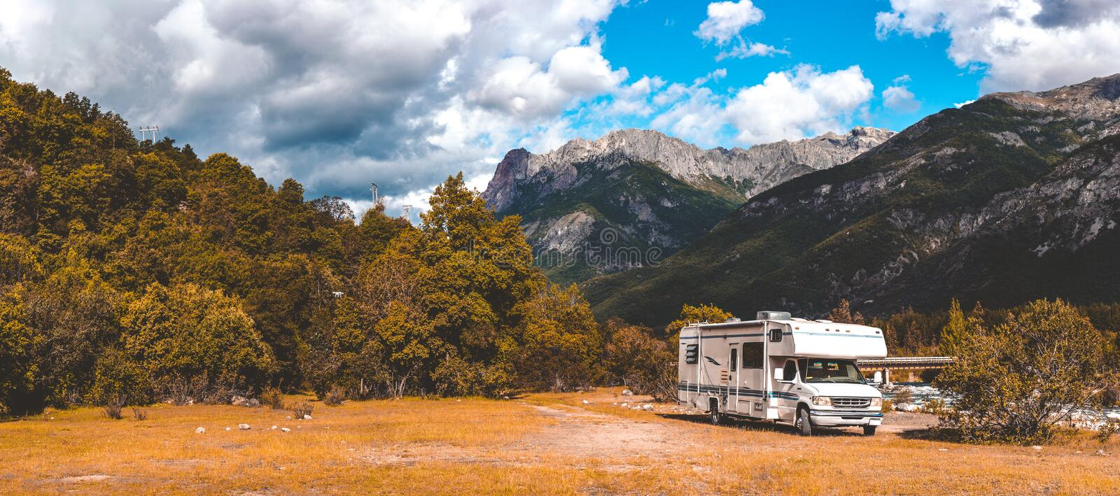 Panoramic view of MOTORHOME RV In Chilean landscape in Andes. Family trip traval vacation in mauntains stock photography